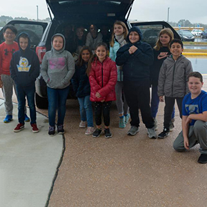 LCE CAP students helped load the van with canned goods and non-perishables.