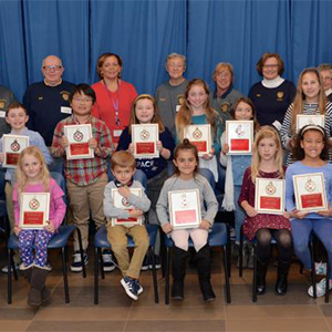 Students recognized by Lewes Fire Department for their fire prevention essays.