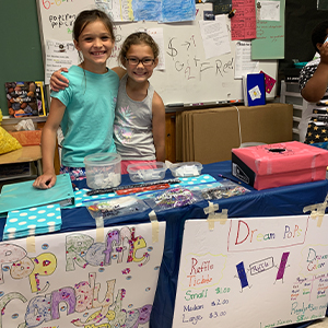 Running a candy raffle shop are Kailey McMahon, left, and Isabella Fitzgerald.