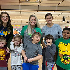 Lewes School students pose with their teachers between their bowling games.