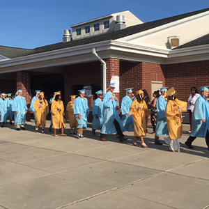 Cape High seniors proceed through the entrance to Legends Stadium June 4.
