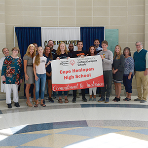 Students and staff Accepting the Special Olympics Delaware Unified Champion Banner.