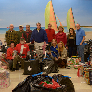 Cape community caring volunteers helped organize the gifts at The Crossing.