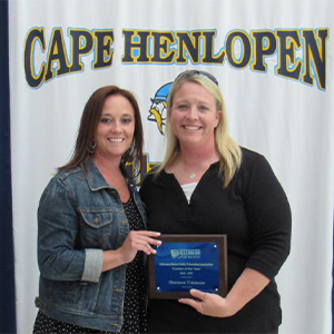 CHHS Principal Nikki Miller congratulates Driver Education Teacher of the Year Shannon Timmons