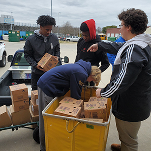 Students from Cape Henlopen High School helped to unload the boxes of donations.
