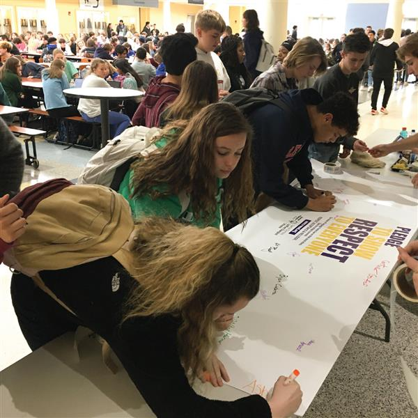 Students at CHHS take the pledge during their lunch period by signing the banner.